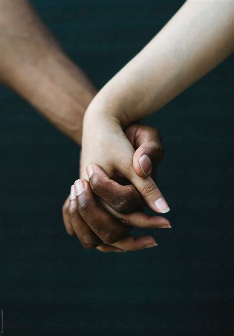 Mixed-Race Couple Holding Hands   Stocksy United
