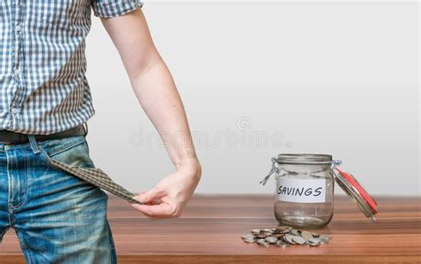 Man Showing Pocket As No Money Symbol And Jar With Coins